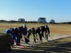 Volunteers laying sod PS