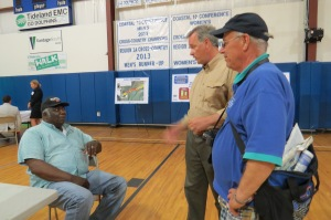 Ed Goodwin, NC Ferry Division director,center, talks with Lorenzo Farrow, a driver with Hyde County Transit, left, and Peter Vankevich, right.