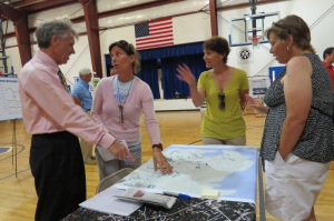 From left, Bill Barrow, a senior transportation consultant with Volkert Inc., who is conducting the feasibility study, discusses possibilities for village transportation with Ann Warner, Susan Burt Collins and Beverly Paul, director of Hyde County Transit.
