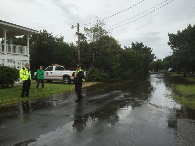 EMS responders Sandy Yeatts, left, and Dana Long, confer with Deputy Sheriff Rob King along Sunset Drive. Photo by C. Leinbach