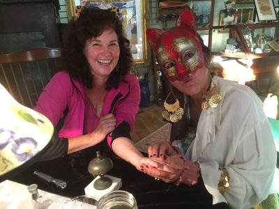 "Melinda Sutton gets her palm read by ""Zelda"" at an Ocracats fundraiser Oct. 22 at Roxy's antiques."