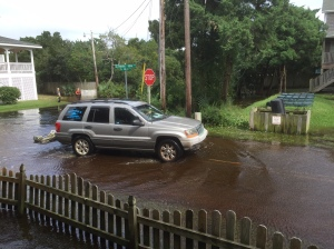 Captain Jason Daniels of the Hyde County Sheriff Department urges all drivers to drive slowly in the standing water to avoid causing a wake.