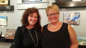 Ocracoke photographersMelinda Fodrie Sutton and Crystal Canterbury at Crystal's opening at Down Creek Gallery