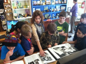 Ocracoke School students in Ocracoke Alive's Arts Partnership Program visit Down Creek Gallery.