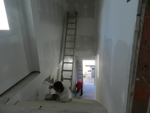 Nasho Villenueva and Juan Gutierrez repaint the main stairwell.