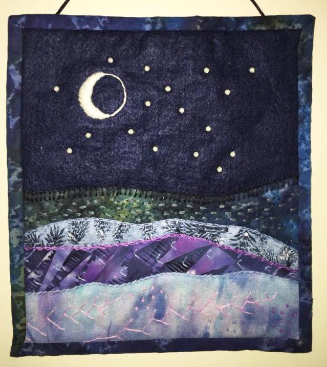 #46 Night Sky Over the Ocean, by Debbie Leonard, island resident, crafter and retired teacher. Fabric (approx. 8 x 9)
