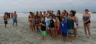 Swimmers pose for a group shot before their swim.