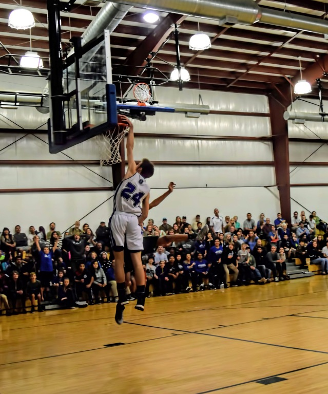 Evin Caswell goes for a dunk. Photo by Melinda Sutton