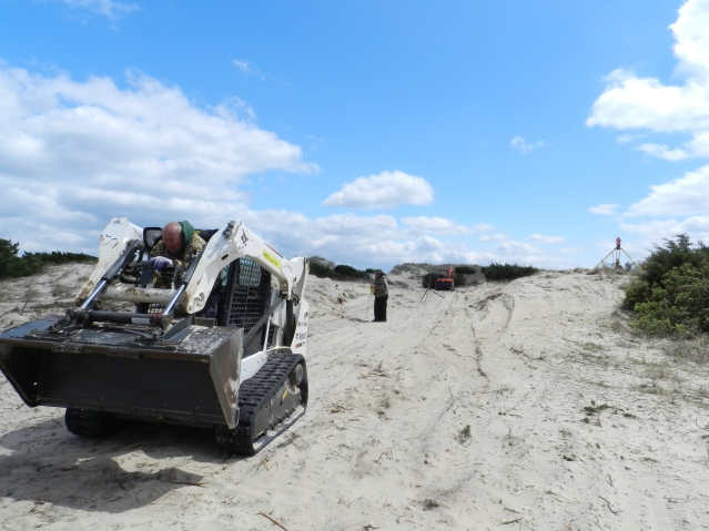 Crews are rebuilding the Lifeguard Beach ramp. Darren Burrus helms the grader.