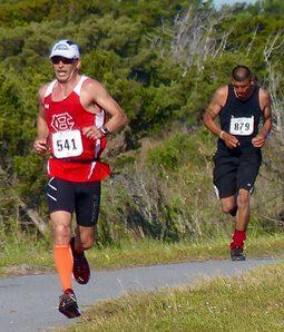Joe Caroppoli of Buxton, left, won the half marathon Sunday on Ocracoke. Chito Guerrero, right, came in second. Photo by Ruth Fordon