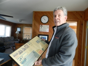 Brownie Futrell shows his lown award-winning editorial that he has framed in in his Ocracoke house.