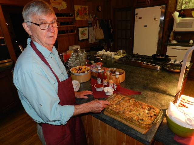 Henry Schliff prepares to serve his bread pudding to diners at The Castle B&B on Ocracoke. Photo: C. Leinbach