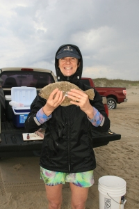 Daphne Bennink with a flounder she caught. Photo by Trudy Austin