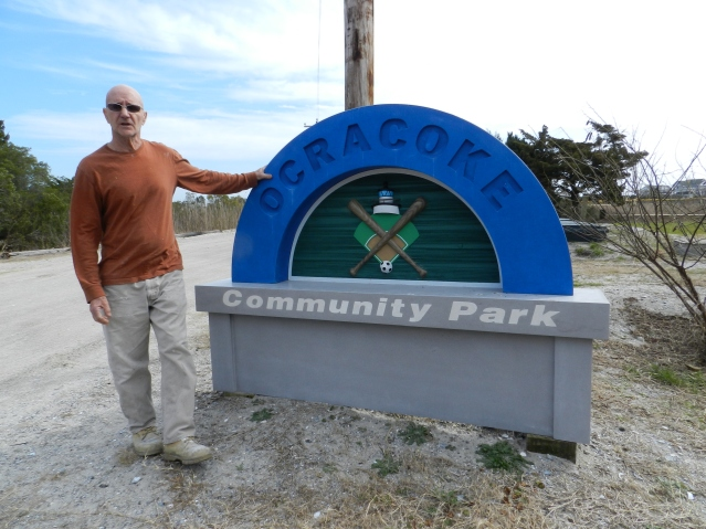 Tony Sylvester with his collaborative concrete and wood monument for Ocracoke Community Park