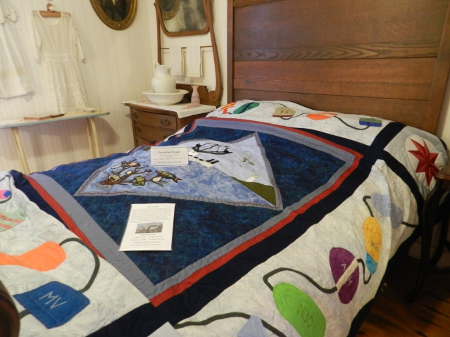 This quilt by the Ocracoke Needle and Thread Club will be raffled Dec. 6. Tickets are on sale at the OPS museum.