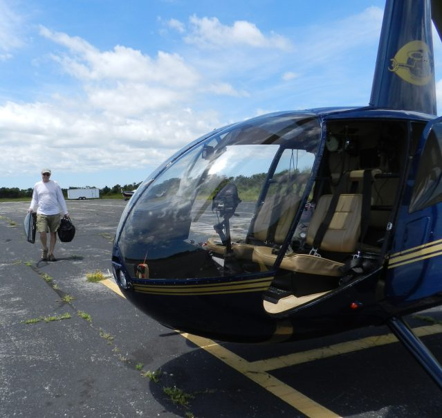 After the tour, Larry Ihle shuts down his helicopter.