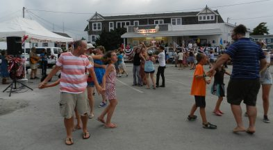 A traditional square dance in Community Square is a family-friendly activity.