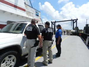 TSA officers chat with a visitor leaving on the ferry at the north end of the island.