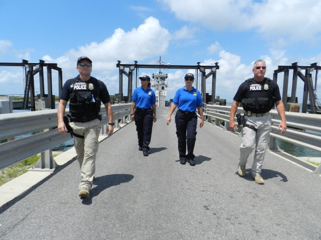 TSA officers finish their on-ferry inspection at the Ocracoke ferry dock at the north end.