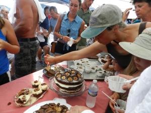 Fig Cake Bake-Off attendees dig in.
