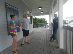 Kyle and Jonathan Brown of Wake Forrest and Sean Benson of Fayetteville await word of a Swan Quarter ferry departure. Photo: C. Leinbach