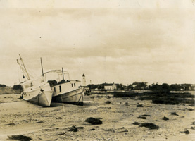 The mailboat Aleta and another boat are left high and dry near the Island Inn after the storm of 1944.