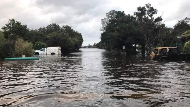 As were many other village streets, Irvin Garrish Highway was a river after Hurricane Matthew passed Ocracoke Oct. 9. Photo by Byron Miller